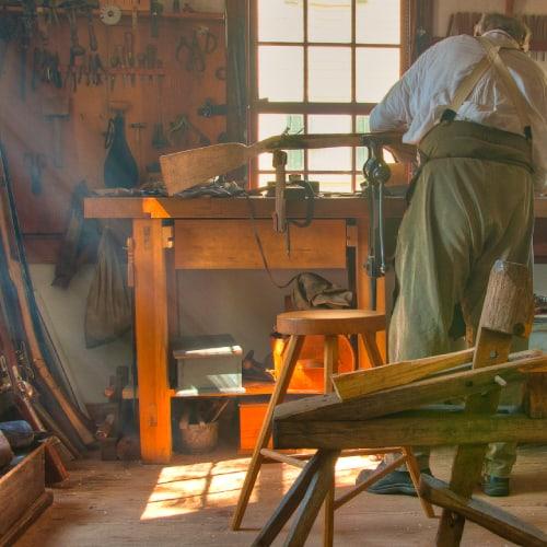 gunsmith at work in his shop