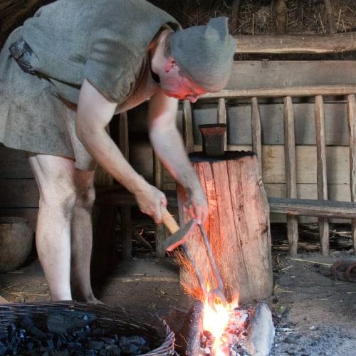 iron age blacksmith at forge